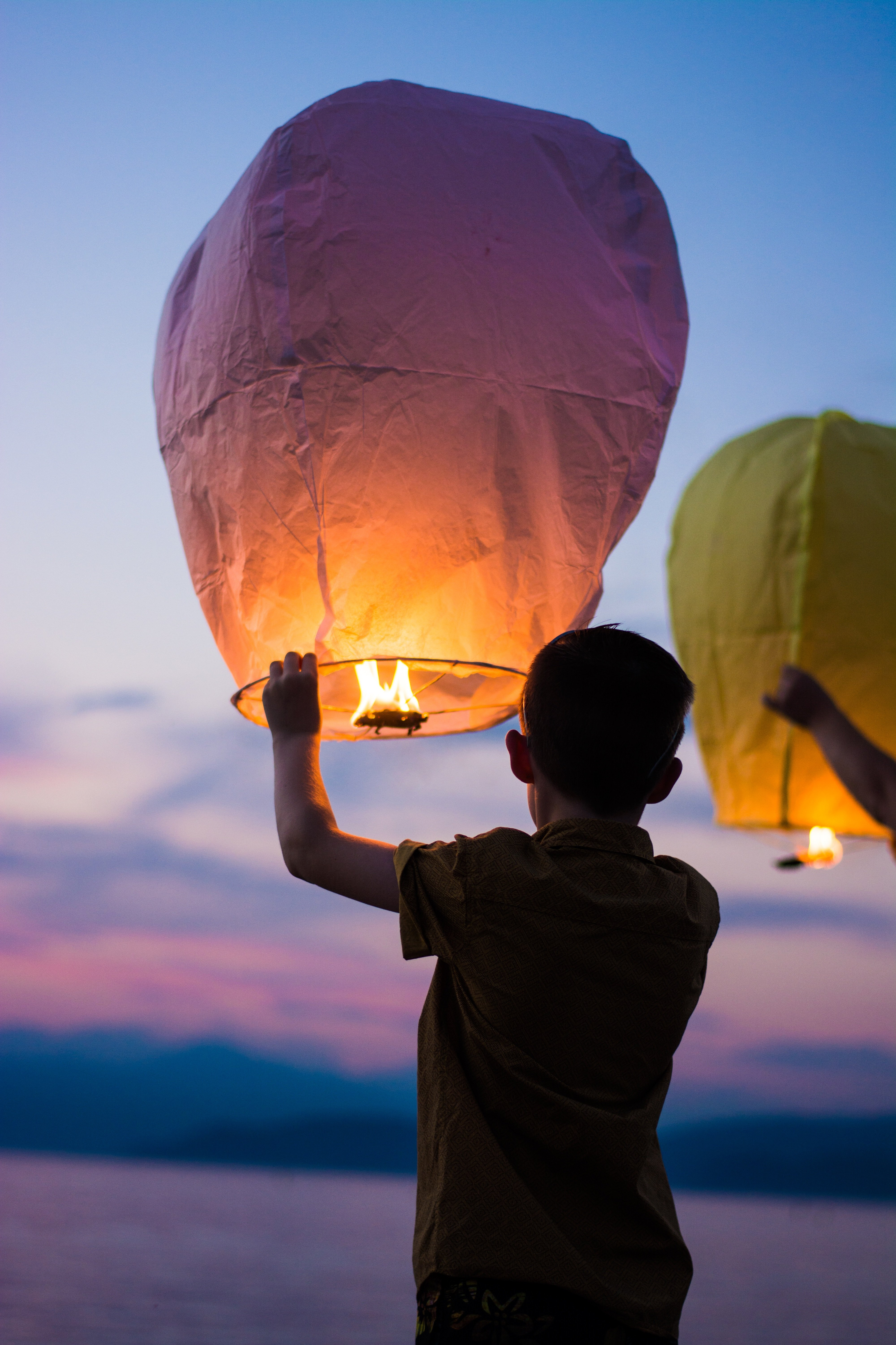 Boy releasing a balloon into the air for his pet