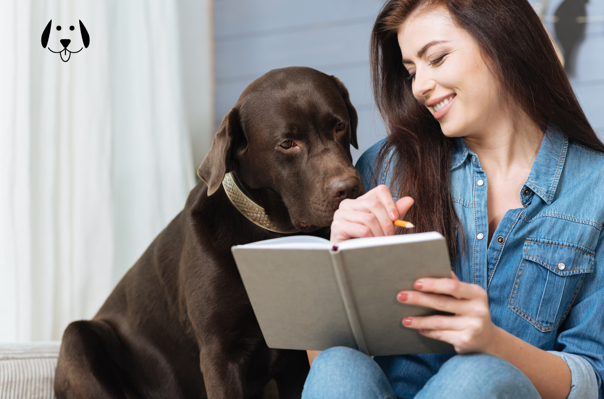 Woman writing dog schedule in notebook with dog looking over the shoulder.